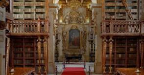 La magia dell'antica biblioteca barocca di Coimbra - Foto